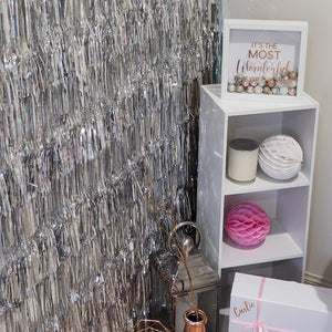 Layered fringe metallic backdrop