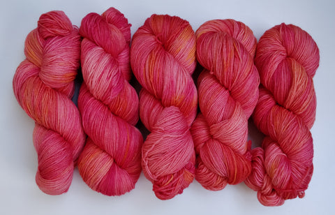 Peach sunset sustainable merino fingering
