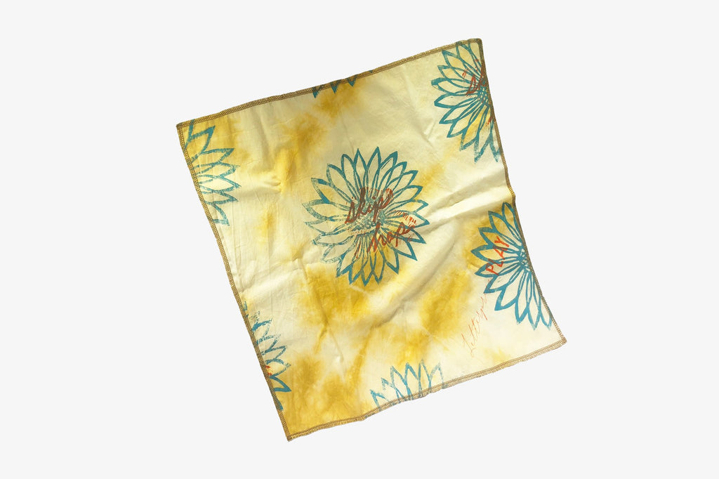 Block printed and hand dyed organic cotton bandana with yellow and green sunflower print, skip hop screen print, full view