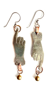 medium hand with ring earrings