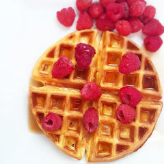 waffle with raspberries and syrup