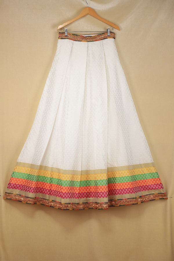 White Banarsi Silk Lengha with Multicoloured borders and Gota style lace finishing