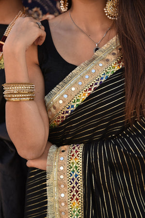 Black and Gold Shimmer, Multi coloured gota style detailing and Mirror Kiran Finishing Saari