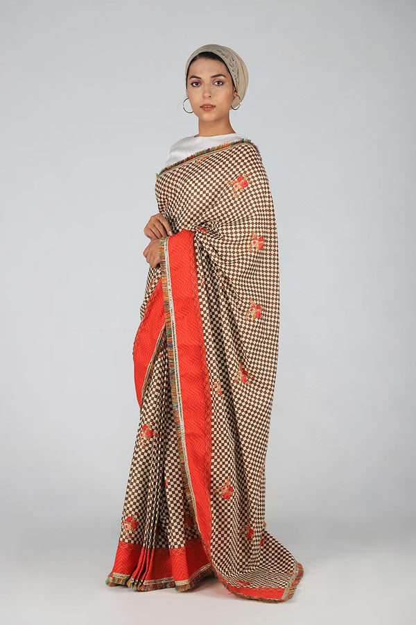 Earthy Toned with Pop of Orange Checkered and floral Saari with Multi coloured fray edging and Unstitched White Cotton Silk Blouse