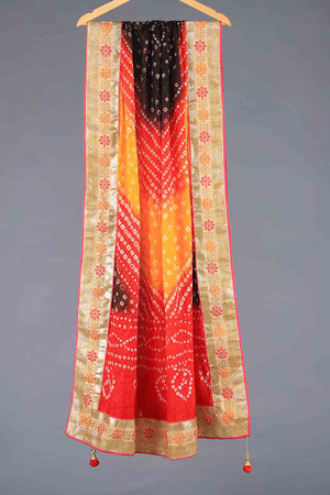 RED, YELLOW AND BLACK TIE DYED SHADED CHUNRI SILK DUPATTA WITH GOTA BORDER AND TASSLE DETAILS