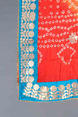 RED, ORANGE AND AQUA BLUE TIE DYED SHADED CHUNRI SILK DUPATTA WITH GOTA WORK DETAILS