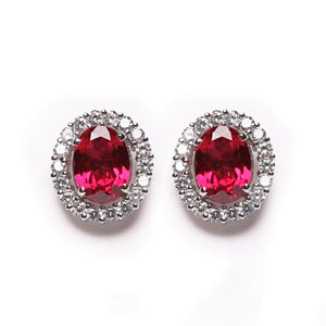 Ruby gemstone stud earrings with diamonds around the stone