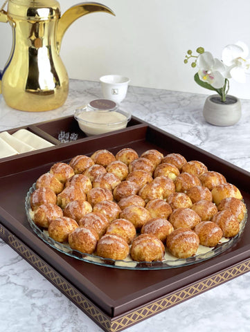 Cinnamon Balls with Cheesy Sauce