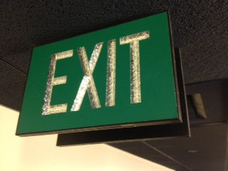 Double sided green exit sign