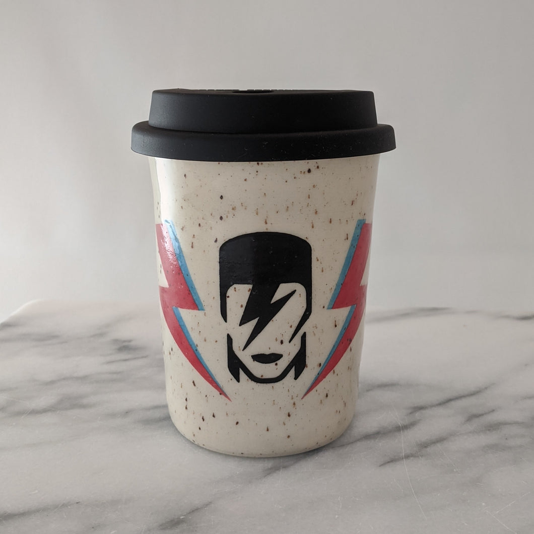 Bowie travel mug in speckled clay with a black silicone lid