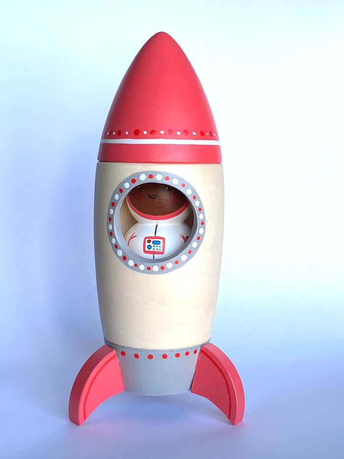 A Wooden Toy Rocket with Astronaut
