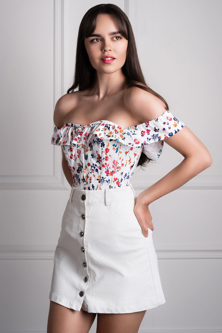 Top a corsetto in cotone con fantasia floreale