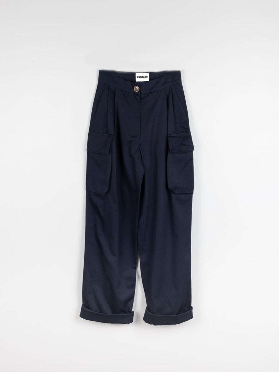Organic Cotton Navy Utility Cargo Pant with two side pockets & buckles on the ankles. Sustainably made in the UK by ethical clothing brand Fanfare Label