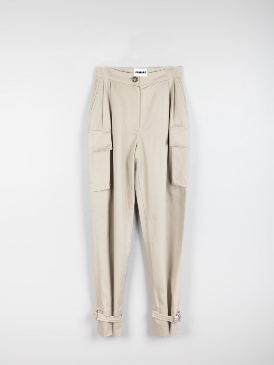 Organic Cotton Beige Utility Cargo Pant with two side pockets & buckles on the ankles. Sustainably made in the UK by ethical clothing brand Fanfare Label