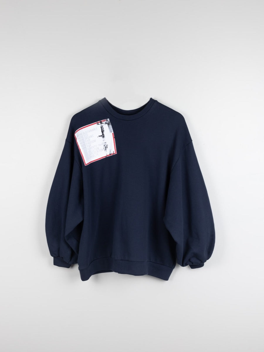 Navy oversized organic cotton jumper with oversized pleated sleeves and sustainable patches. Made by ethical clothing brand Fanfare Label.