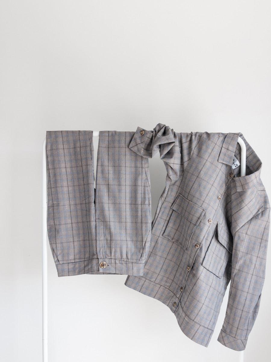 Check oversized shirt suit jacket with larger pockets on the front,  made from cotton. Designed & made in the UK by sustainable clothing brand Fanfare Label