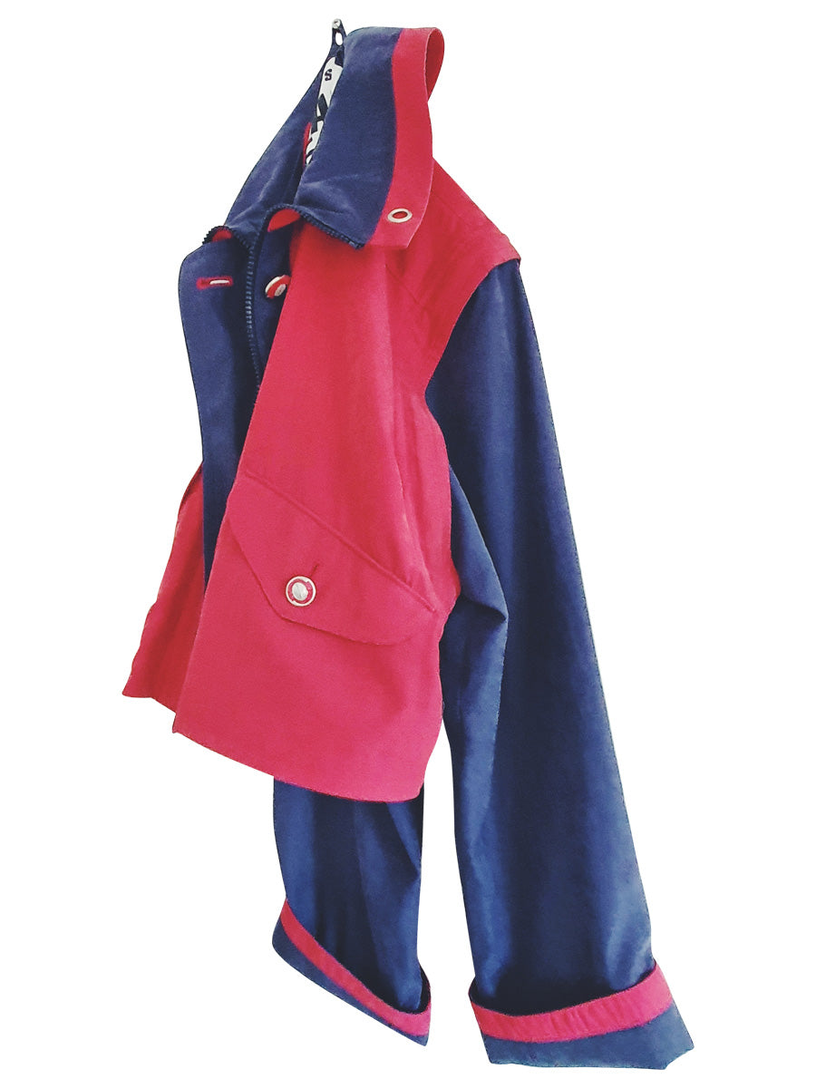 Upcycled red and navy waterproof short coat with removable sleeves, this jacket can also be worn as a gilet. Crafted by Fanfare artisans in our sustainable London-based factories.