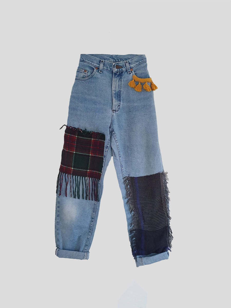 Our upcycled & recycled blue high waisted jeans, come with patches. They are relaxed fit and have rolled up cuffs. Fanfare Label is a sustainable women's clothing brand, using organic & recycled materials, all our product is handmade in the UK. Our ethically produced clothing is seasonless & of high quality.