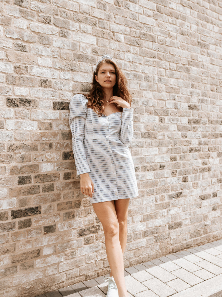 Organic Cotton Blue & White Check Volume Shoulder Dress. Made from 100% GOTs certified Organic Cotton, sustainable made in the UK by ethical clothing company Fanfare Label.
