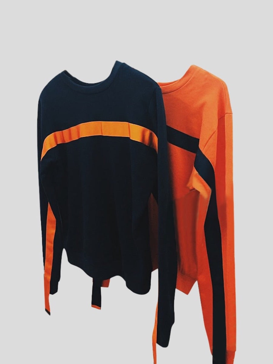 Organic cotton orange jumper with long sleeves and a navy stripe. Made in the UK by sustainable women's clothing brand Fanfare Label