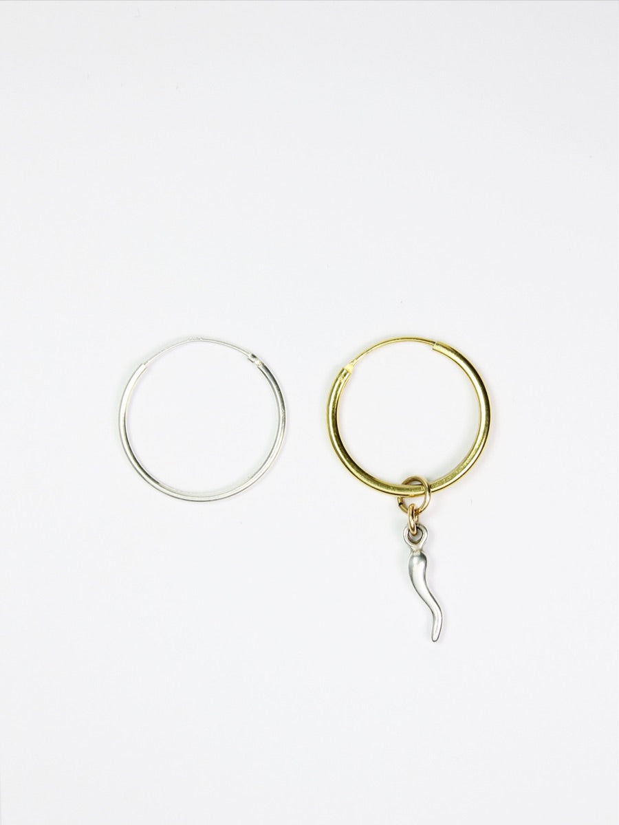 gold mis match hoops, one silver hoop one gold with a chilly  Edit alt text