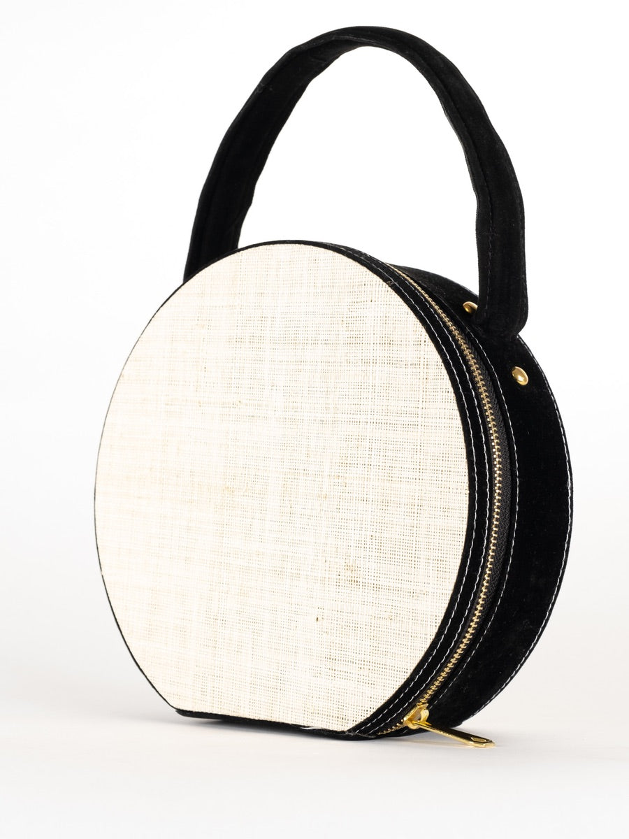 This raffia sustainable black and white circle clutch bag summer bag.