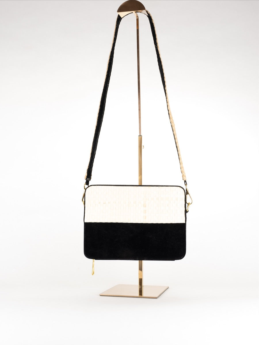 This sustainable Black & White Suede Bag is perfect for the summer.