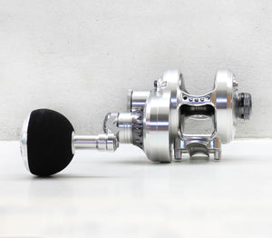 Poseidon NEXT 200 Jigging Reel Silver Gunsmoke