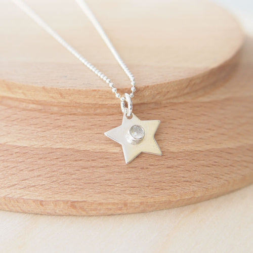 Sterling Silver Star with White Topaz for April's Birthstone