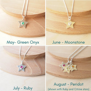Silver Birthstone Star necklaces showing May, June, Jiuly and August Birthstones