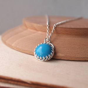 Silver and Turquoise Pendant Necklace with a filigree design setting