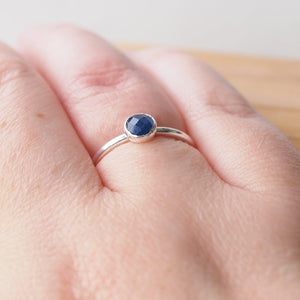Scale picture of maram jewellery sapphire ring worn on hand