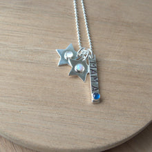 Load image into Gallery viewer, personalised mothers necklace with silver bar stamped 'mama' with a sapphire and two stars with birthstones for children in opal and moonstone