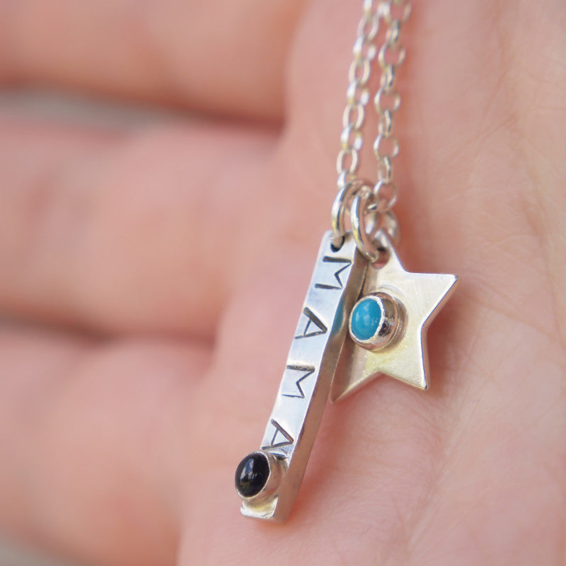 Silver necklace with bar stamped 'mama' and bithstone with additional star pendants with birthstone centres