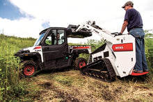 Mini Skid Steer Loading A Work ATV With Dirt
