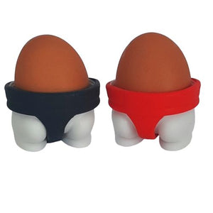 black and red sumo wrestler egg cups