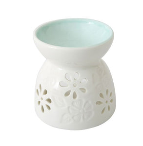 blue and white ceramic oil burner
