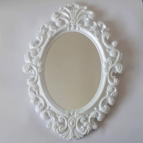 white small oval mirror