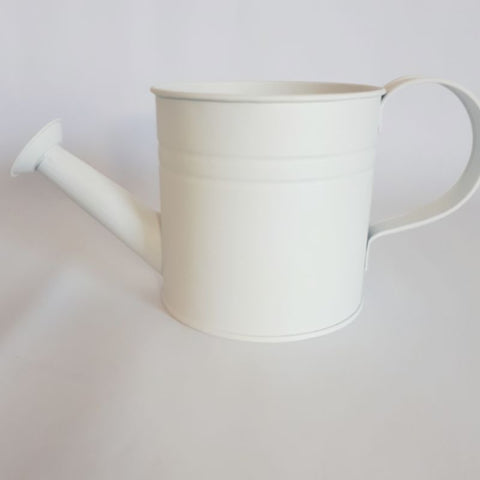 small white watering can