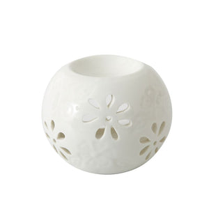 white round ceramic oil burner