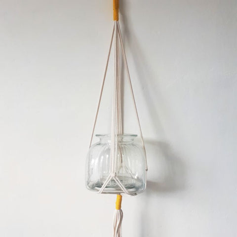 yellow and white macrame rope pot plant hanger