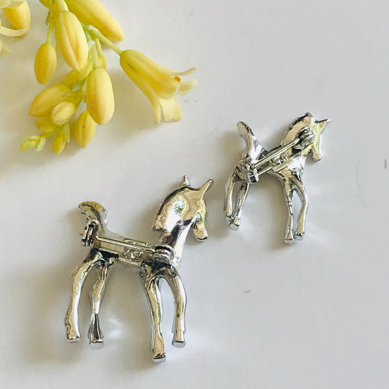 Vintage Pair of Asymmetrical Sized Pony Brooches