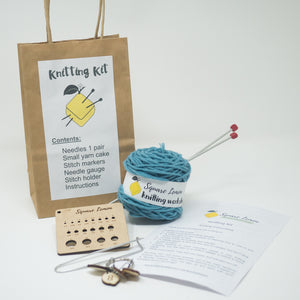 Knitting Kit, preloved knitting needles, cake of yarn, needle gauge, stitch markers, instructions, stitch holder