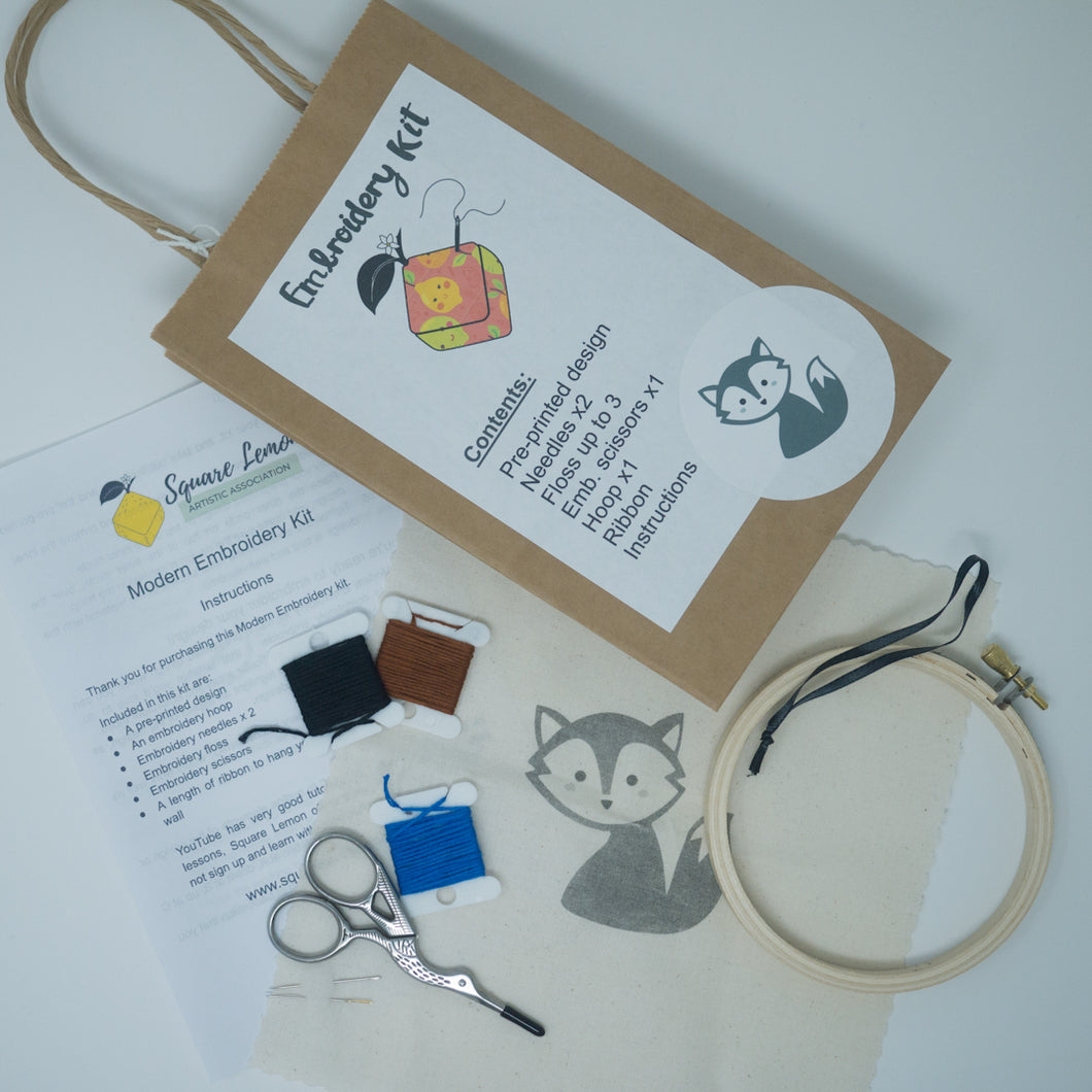 Embroidery kit containing printed image, embroidery floss, needles, scissors and hoop
