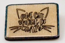 Load image into Gallery viewer, Laser-Engraved, Resin-Coated One Cat Short of Crazy Badge