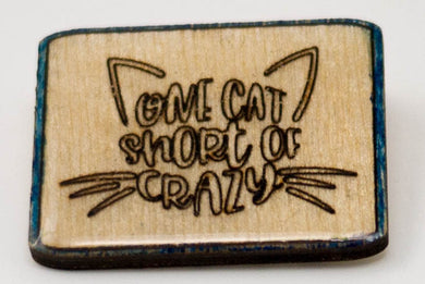 Laser-Engraved, Resin-Coated One Cat Short of Crazy Badge