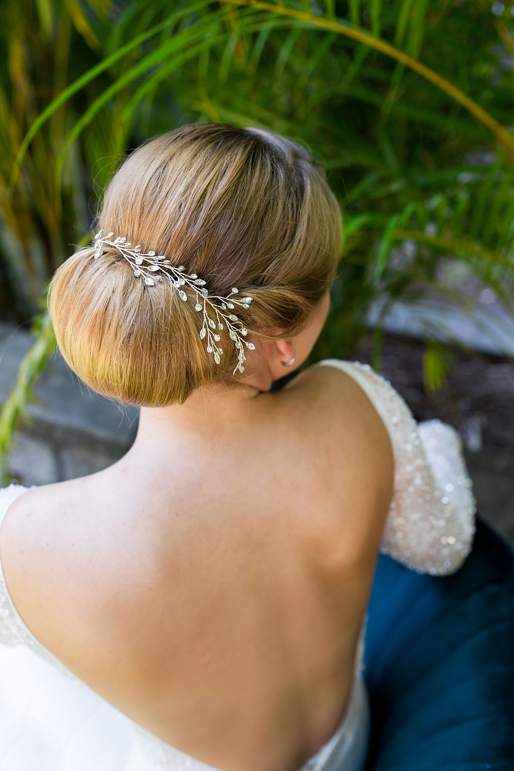 low sleek bridal bun hair accessories