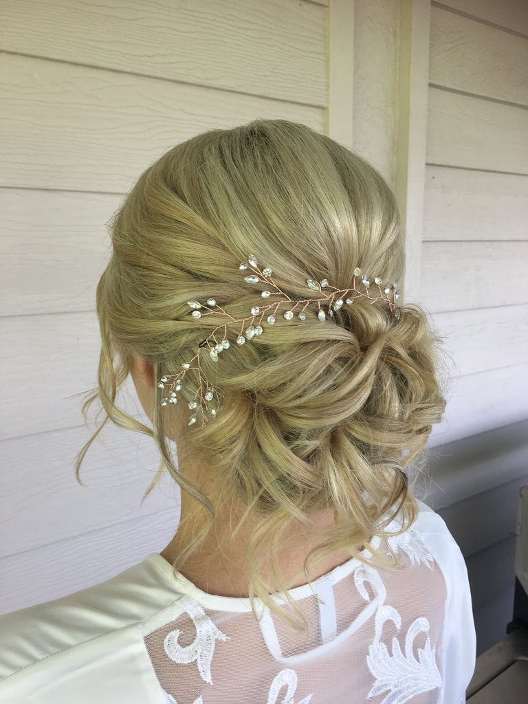 soft romantic wedding hair with bridal accessories