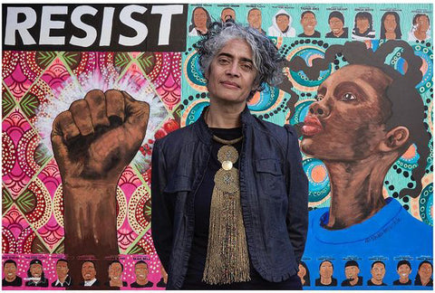 Sharon Virtue in front of her mural, image by Harvey Castro
