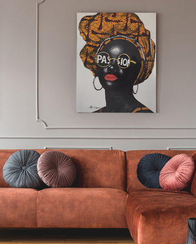 Colourful mixed media portrait above sofa by Nigerian artist